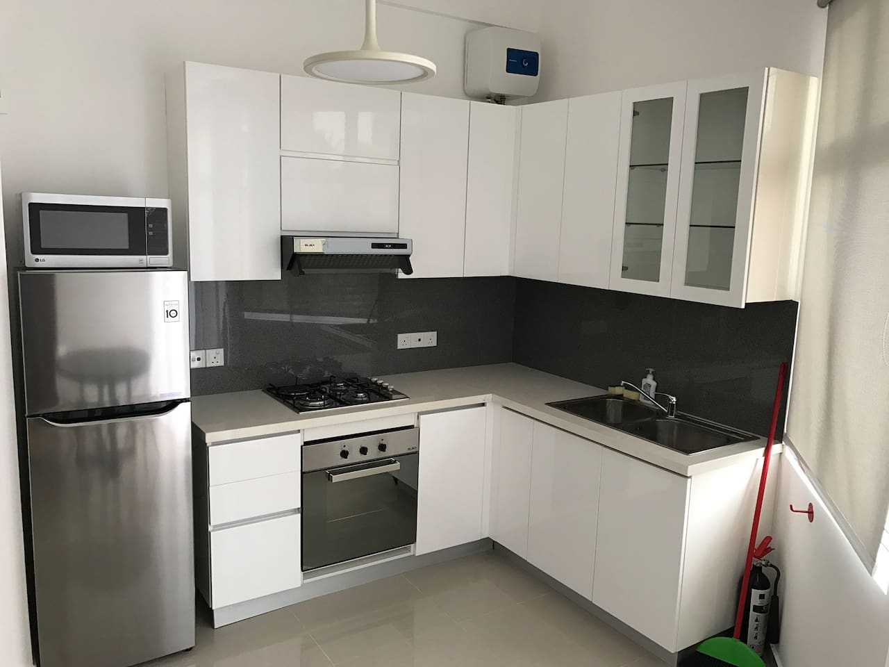 Pantry area with refrigerator, 4 gas burners, full electric oven and heater and the microwave oven