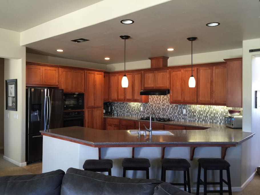 Large kitchen with all amenities. Help yourself to what's in the pantry or fridge.