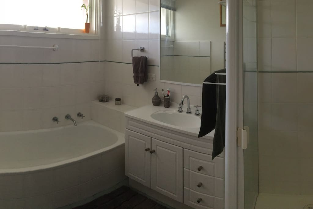 Main bathroom with shower, vanity and bath. Heated towel rail also. Separate toilet.