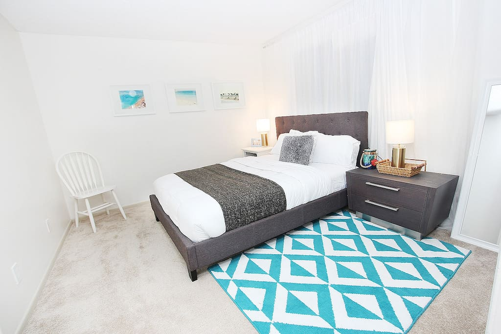 Cozy queen bed with 2 twin beds for guests.
