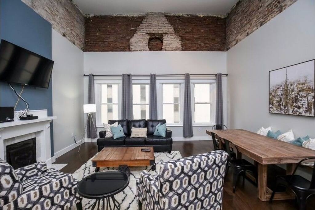 Exposed brick with great natural light from the large windows that look right out to 5th Ave in Nashville.
