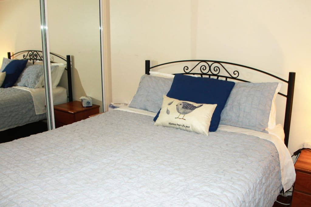 "Master Bedroom ""Bluebird Room"" with Queen bed with freshly made white linen and fluffy towels just for you!"