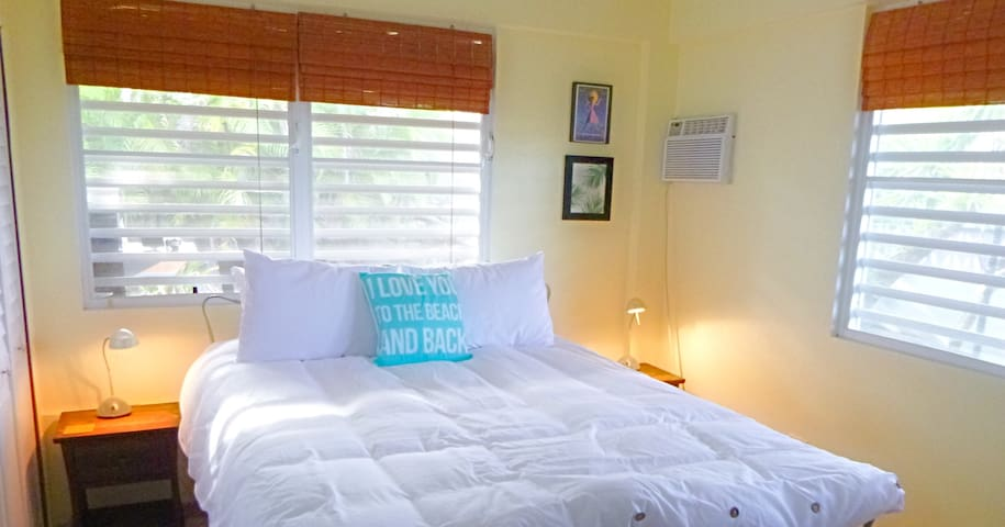 Master bedroom with queen bed, full dresser, air conditioning, wonderful trade wind breeze with sounds of nature.