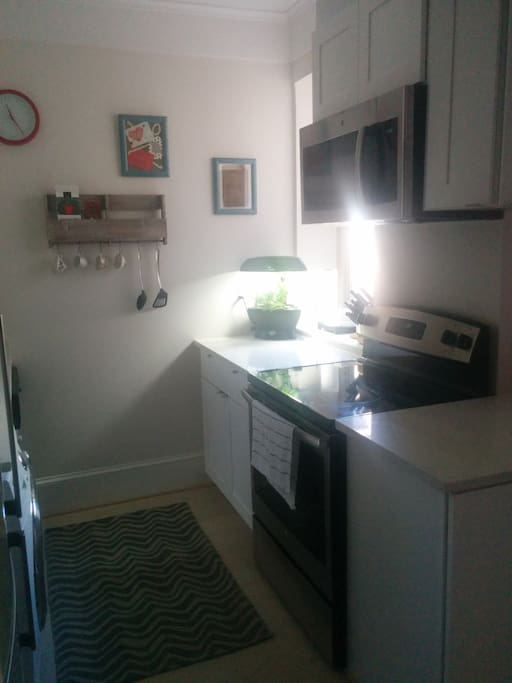 Older photo of kitchen, daytime.