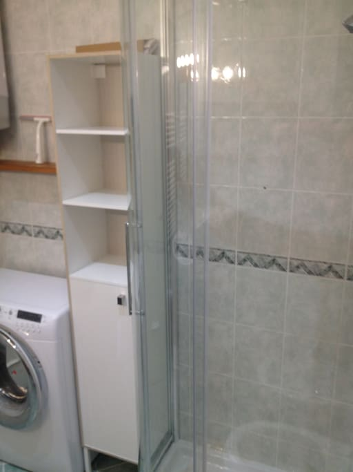 Bathroom with washer and shower