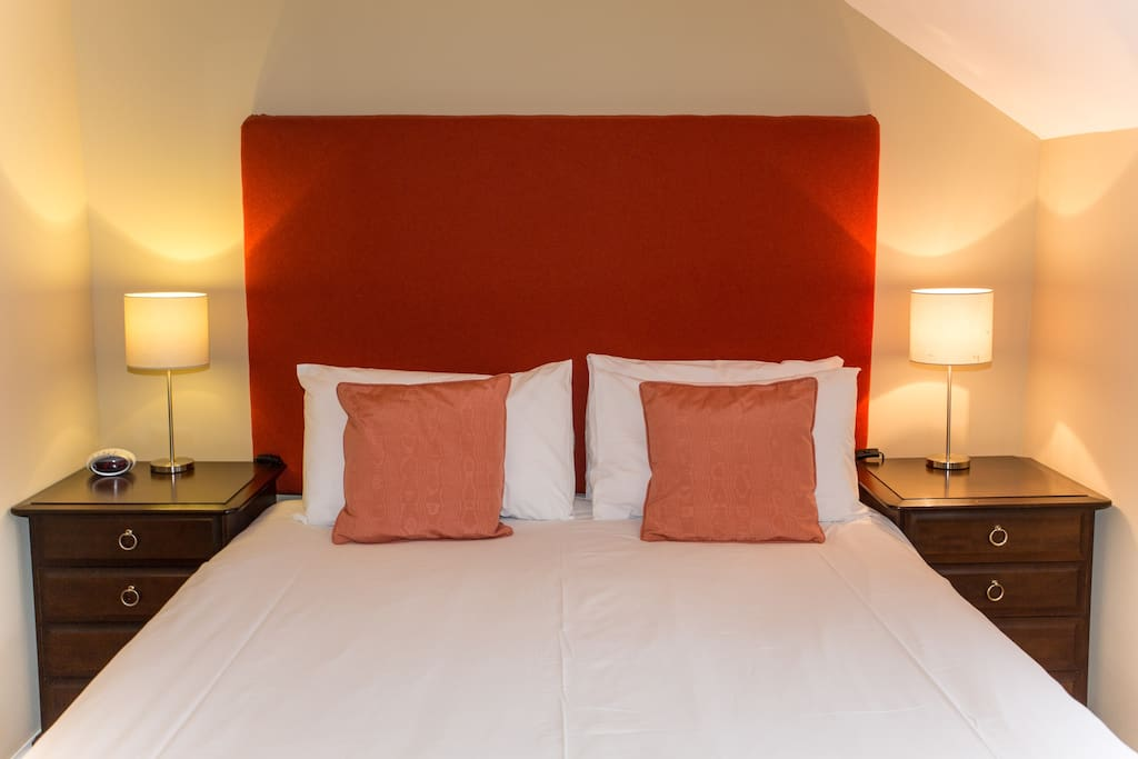 Bespoke headboards and coordinating soft furnishings give each room at Butt Lodge its own distinct character