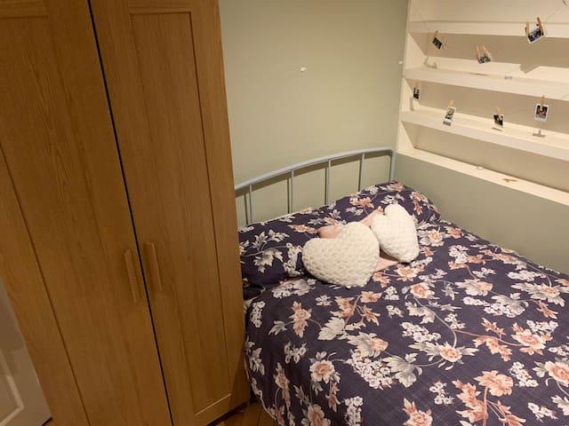 Studio-like floral themed bedroom, central London