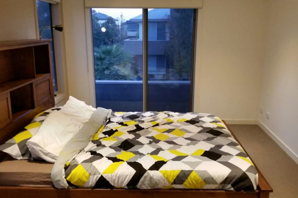 Master bedroom with queen bed, walk in robe and ensuite