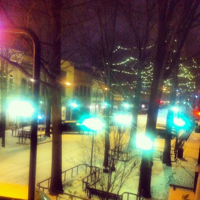 Rare snowfall in Greenville. Main street view toward North main st. and the Hyatt,