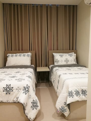 Junior Bedroom - 2 Single Orthopedic Bed for more comfort and black out curtain for extended sleep
