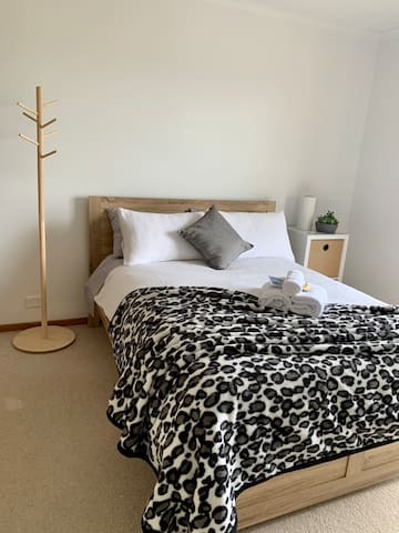 Bedroom 2 - 'Master'- includes double bed, couch, walk-in robe, full length mirror and tall boy.