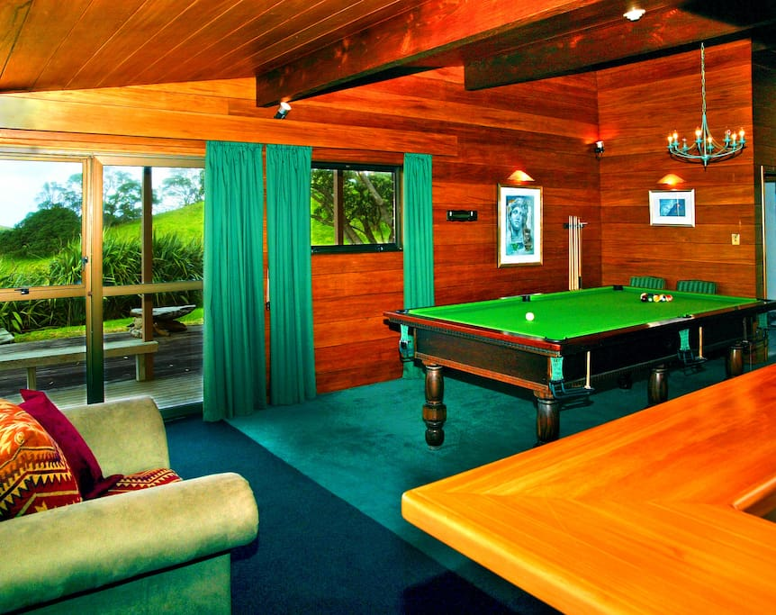 A games room with a pool table