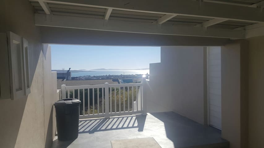 Balcony outside with braai area and 8 seat table