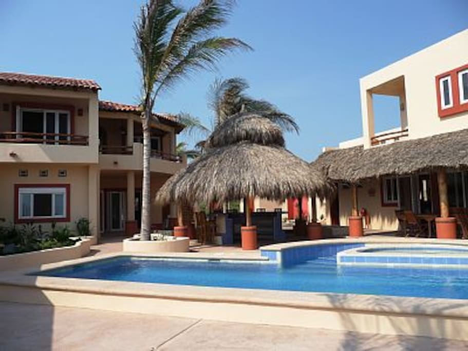 Guest building, palapa bar, main building, pool from beach side