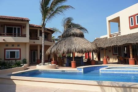 Large beachfront villa for 2-16 guests