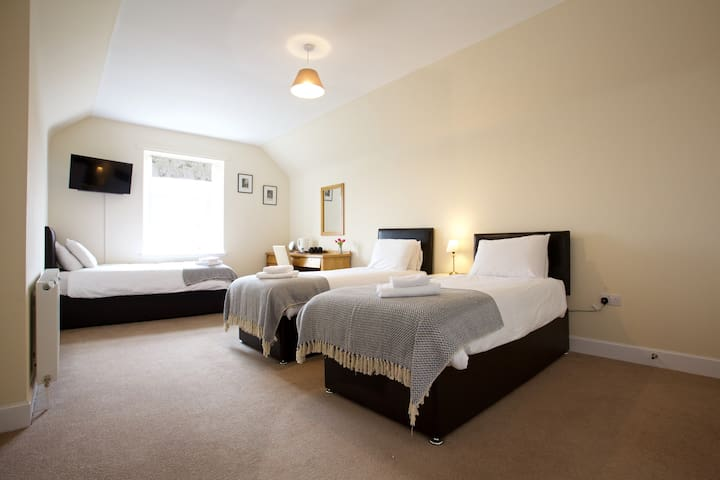 Family bedroom zip and link beds can be made into singles of king size beds. All bedrooms are ensuite