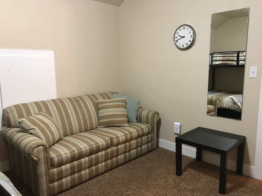 Room Items: Sofa, mirror, USB charging plugs, night stand, 32 inch TV with Roku