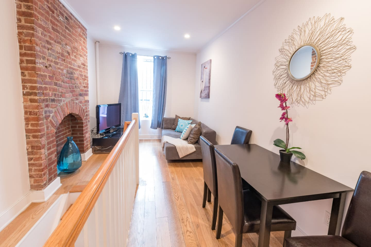 Modern, designed living room with dinning area. Comfortable couch perfect to rest after a long day walking around the city. It can be used as a third bed.