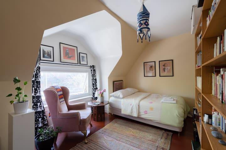 Zen South Facing Bedroom in Quiet Art-Filled Home