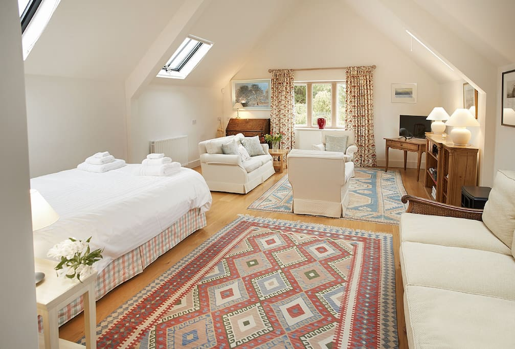 First floor: Open plan sitting room and bedroom with 5' Vispring double bed with antique headboard.