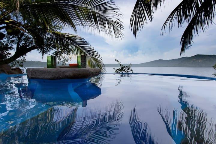 Infinity edge of the pool facing Laguna de Apoyo with seating.