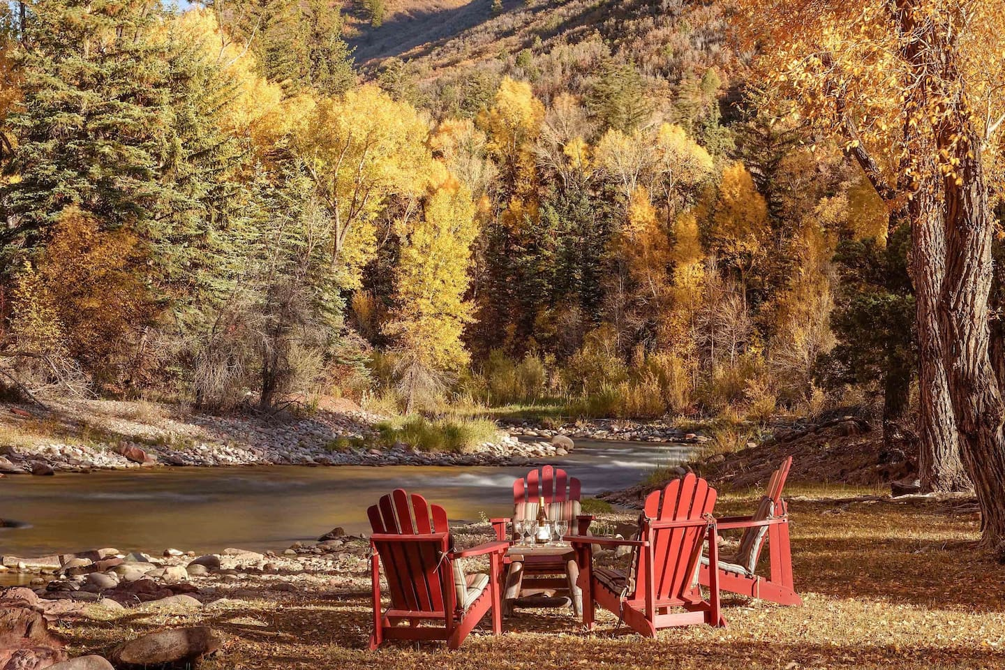 Seating area on the banks of the Roaring Fork River and a short walk from the cabin.