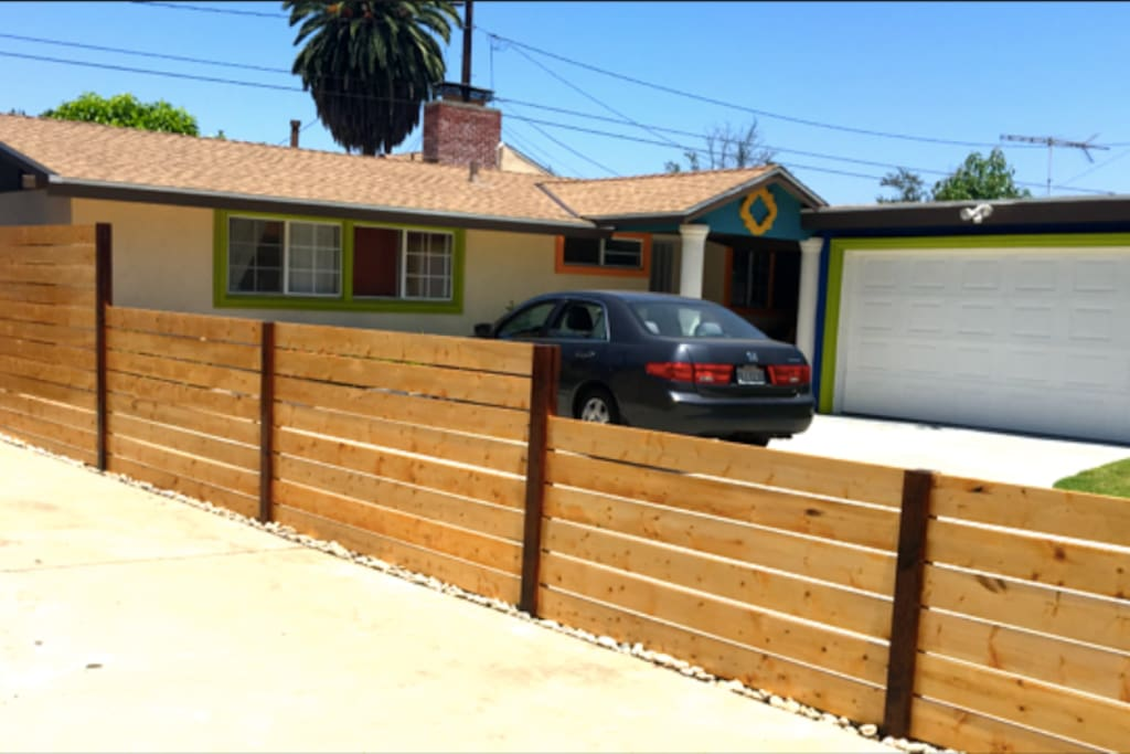 Most colorful house on the block! Can't miss it. Free parking - driveway fits up to 4 cars. Welcome to our magical home! :)