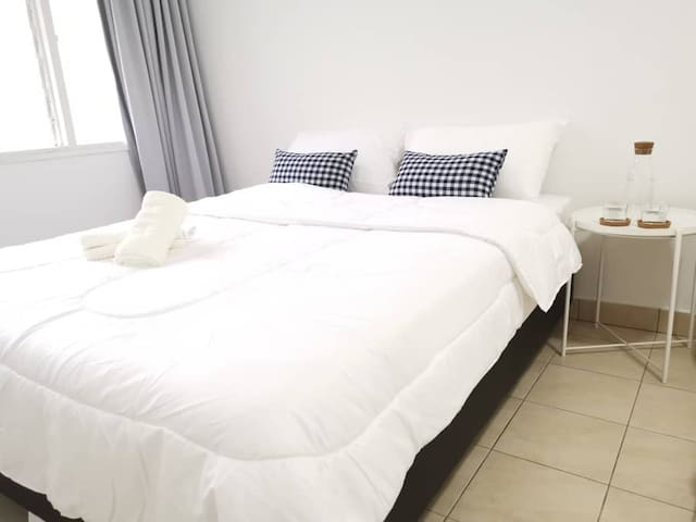 Bedroom 1 - Queen bed.  Quality mattress with full bedlinen.   Additional floor mattress can be added upon request :)