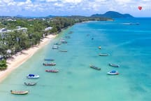 Rawai beach. Where you can hire a long tail boat or speed boat to go to the local islands. Along the beach road they have many beach side restaurants for your eating pleasure.