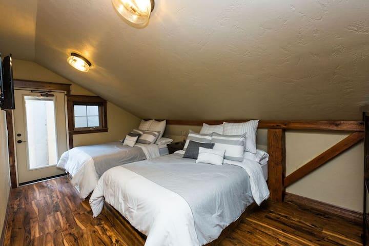upper most bedroom with 2 queen beds