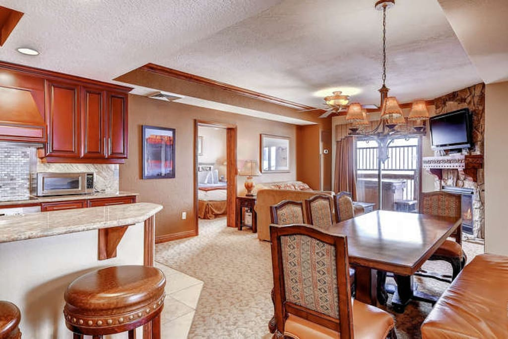 Open concept floor plan; dining table seats 8