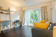 Lounge: sofa, TV and desk