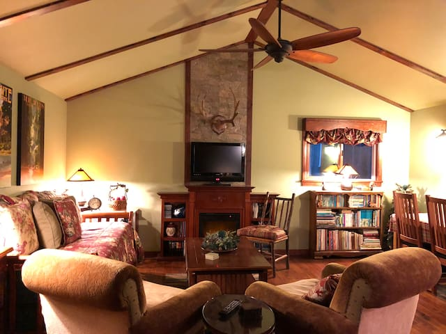 Vaulted ceiling with large paddle fan.