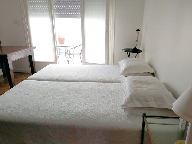 Master bedroom. Bright, spacious, very quiet and private, with plenty of storage space. You can enjoy your breakfast on the balcony!
