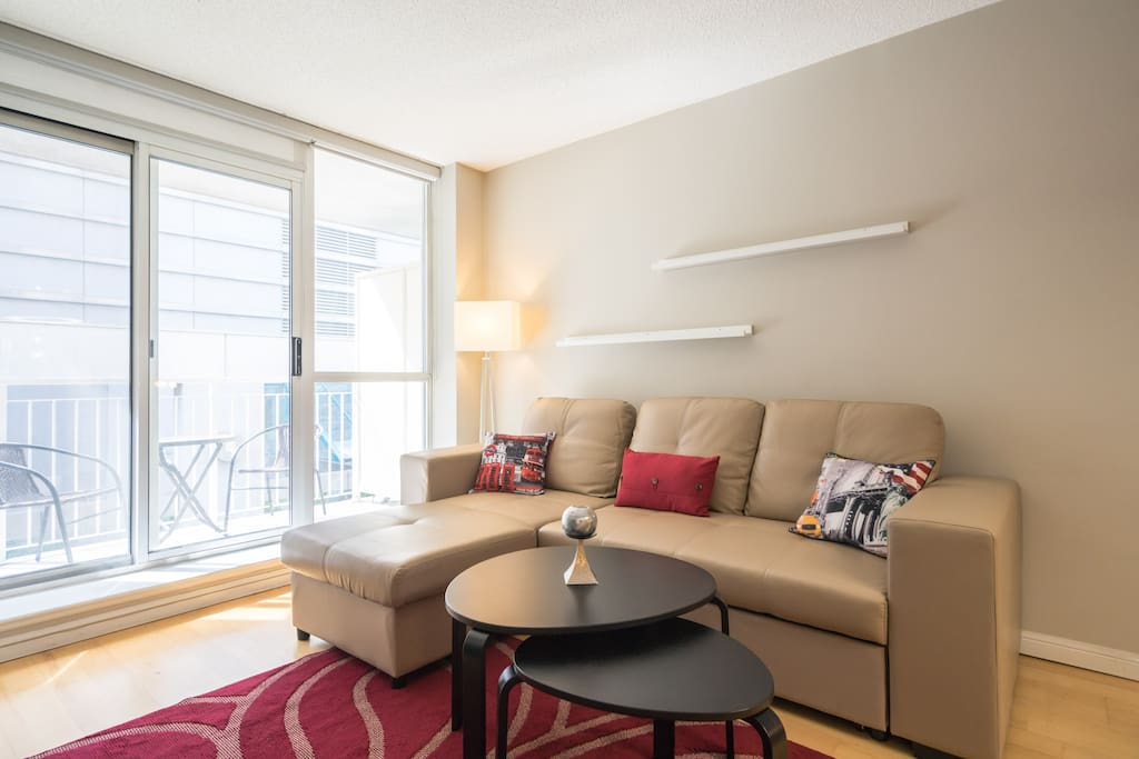 Luxury one bedroom condo has a brand new sofa with pull out bed and chaise for relaxation and comfort.