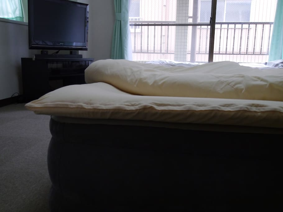 Futon and cover on top of the air bed to make more comfortable to sleep.