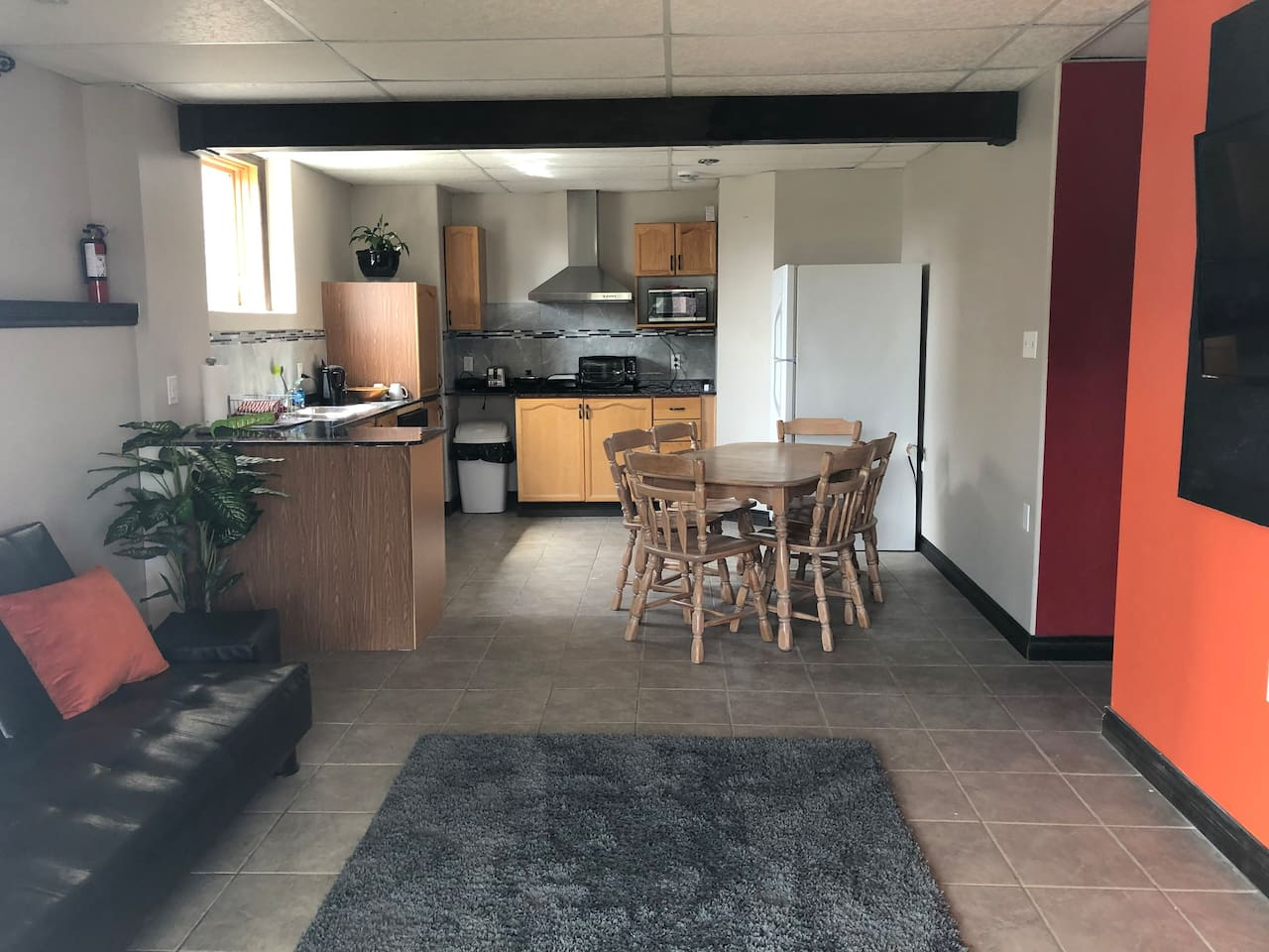 Your kitchen and living room with a big glass slide door overlooking a pond .