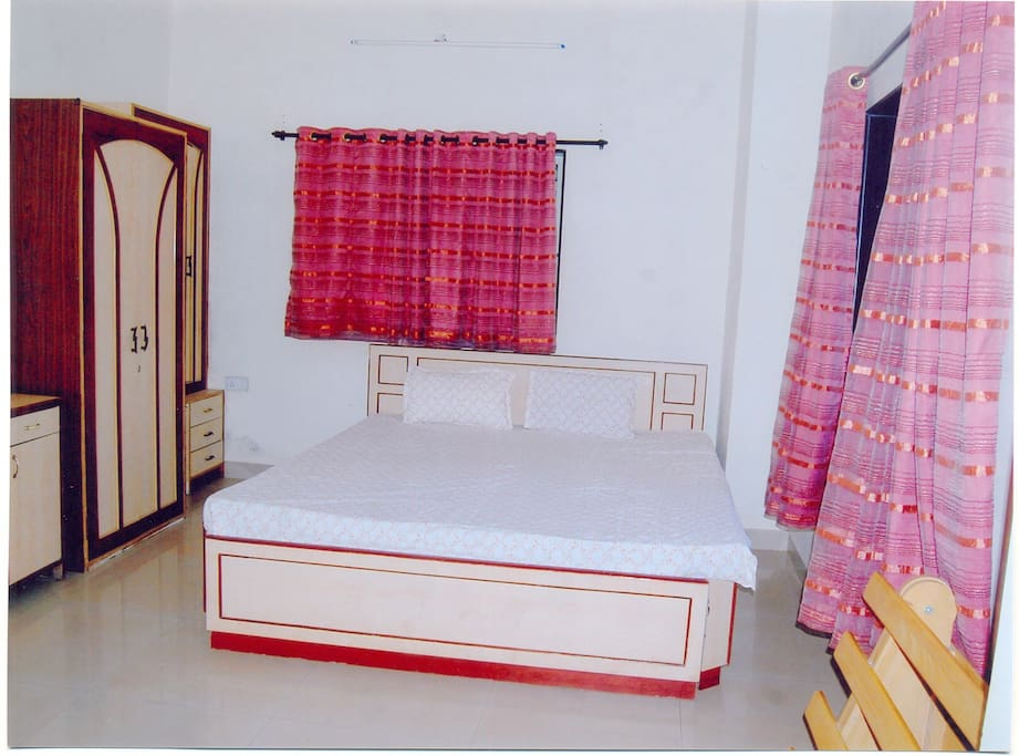 Bedroom with attached bathroom and a King size bed