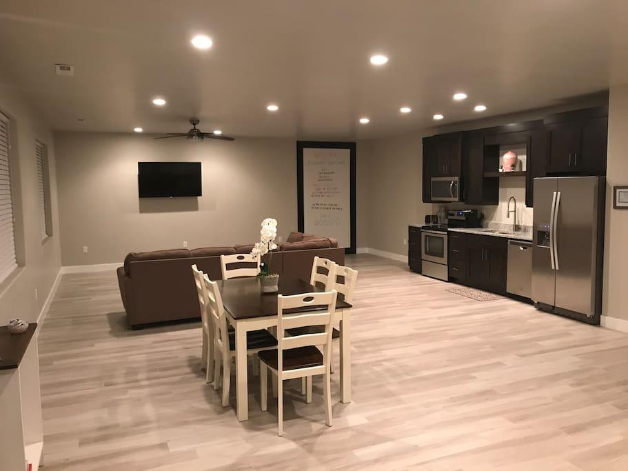 This is the main living space.  The photo is taken as if you had just walked through the sliding glass door.  Very open and spacious.  Great for cooking meals and unwinding after a fun filled day outdoors