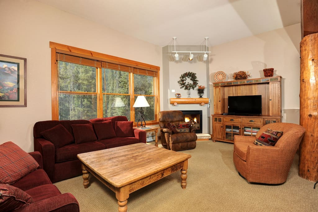 Relax in the cozy living area, complete with fireplace
