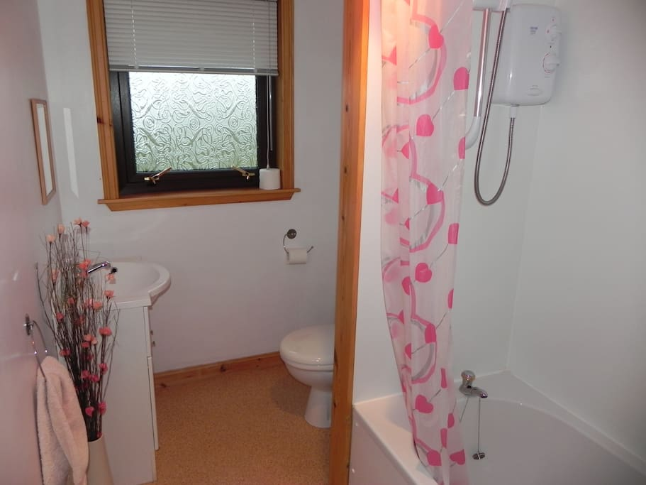 Clean bathroom with shower and bath.