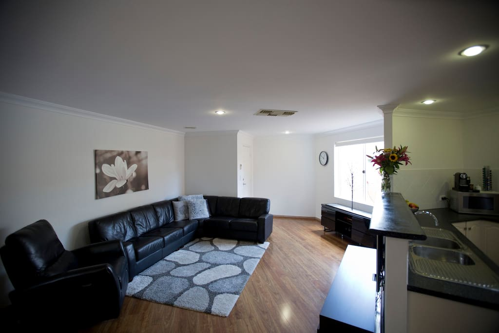 Open plan lounge, dining & kitchen area.