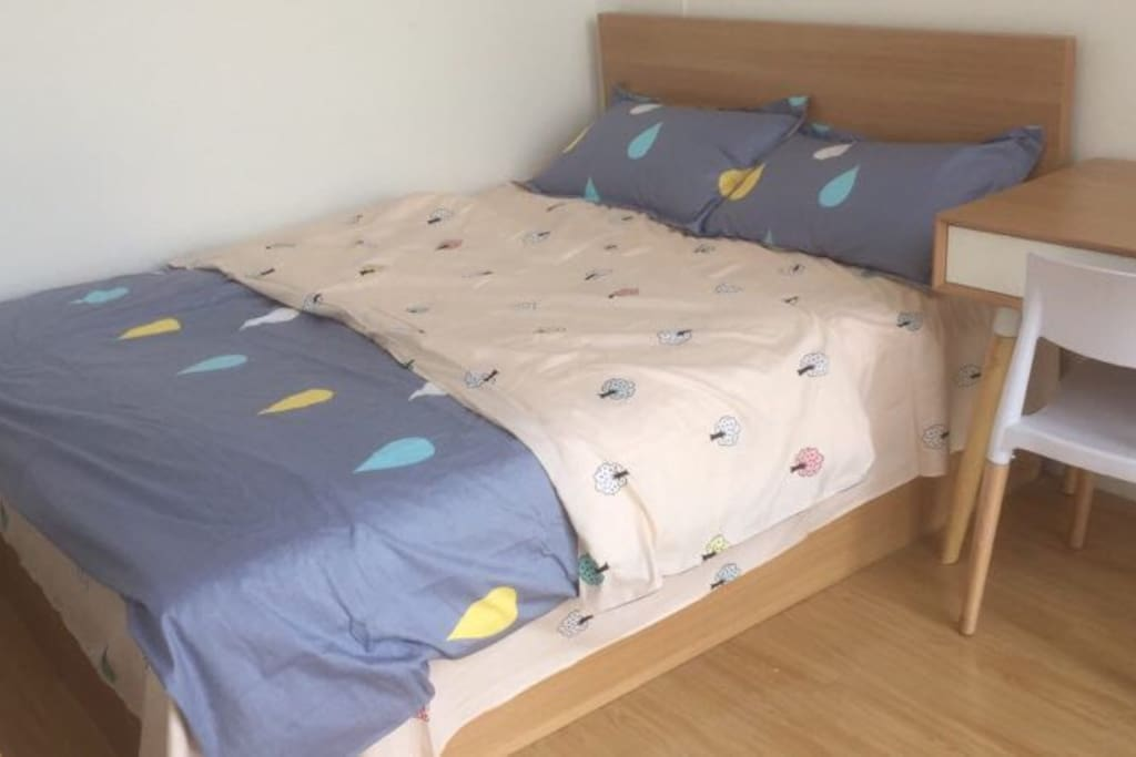 The smaller bedroom with a double bed
