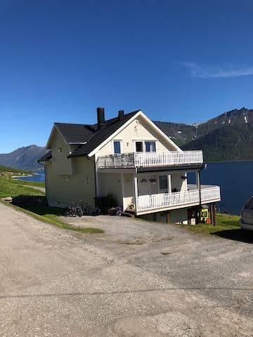 Big house by the sea, beneath the mountain Segla