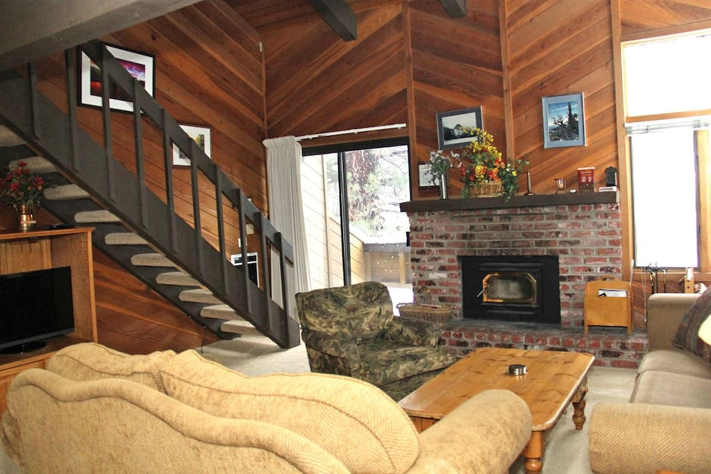 Mammoth Lakes Condo Rental Wildflower 18 - Living Room with Flat Screen TV, Stairs to the Loft