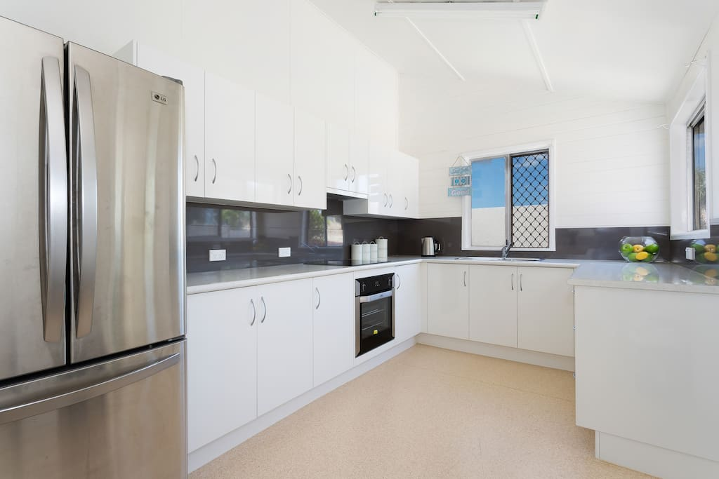 Spacious equipped kitchen.