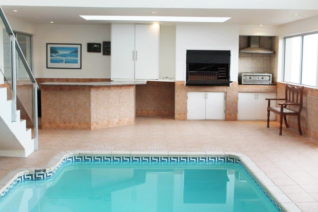 Indoor heated pool with indoor barbecue