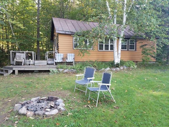 Log camp on Embden Lake