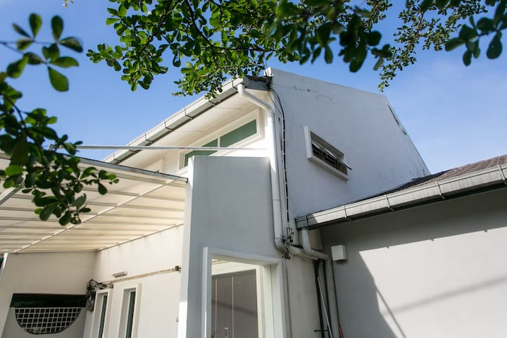 A spacious modern house that can fit 12-18 pax, with a huge garden on the side