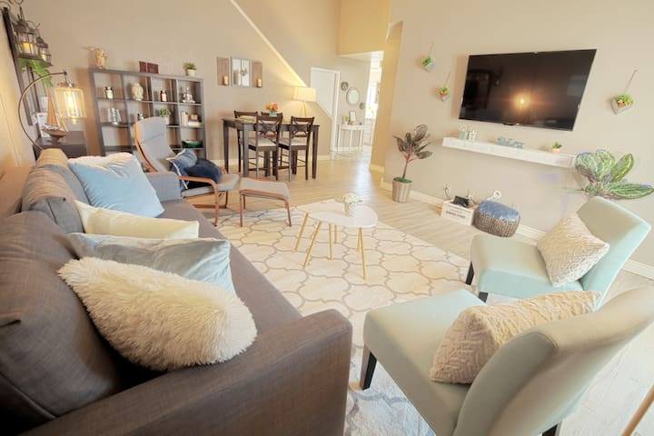 """High open-ceiling living area with large 55"""" Smart TV, Sling TV & Netflix perfect for relaxation and entertainment."""